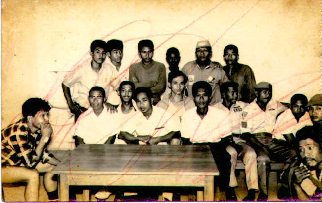 Kawanto, my dad when he was young, sitting on the left corner